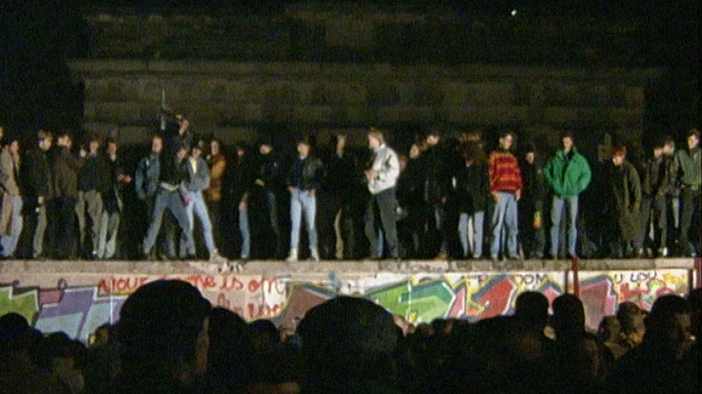 Crowd-on-the-Berlin-Wall-German-Archive